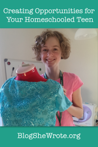 teen girl standing behind her creation on a dressform