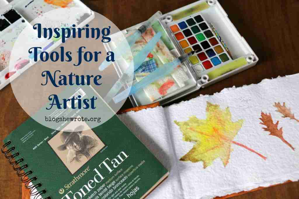 Inspiring Tools for a Nature Artist: journal and paints on a table top
