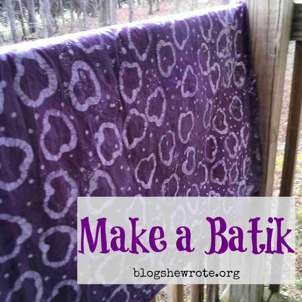 purple batik fabric hanging over a railing
