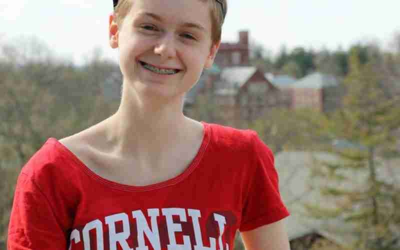 young woman in a Cornell shirt smiling
