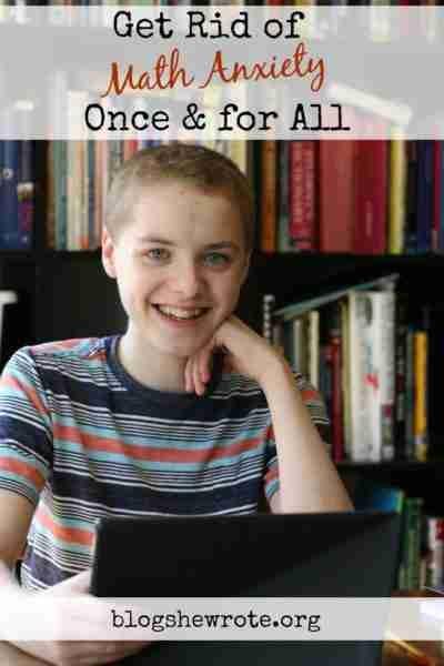 teen boy smiling at a laptop