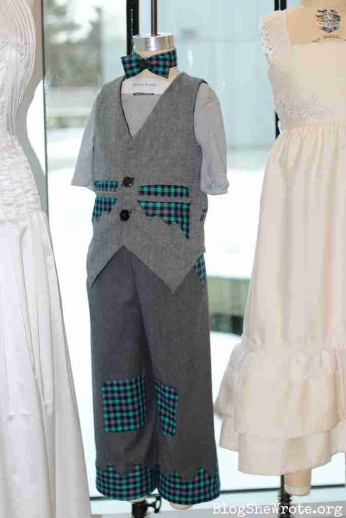 Design School 3- close up of a little boy formal wear design in gray with green and gray plaid accents