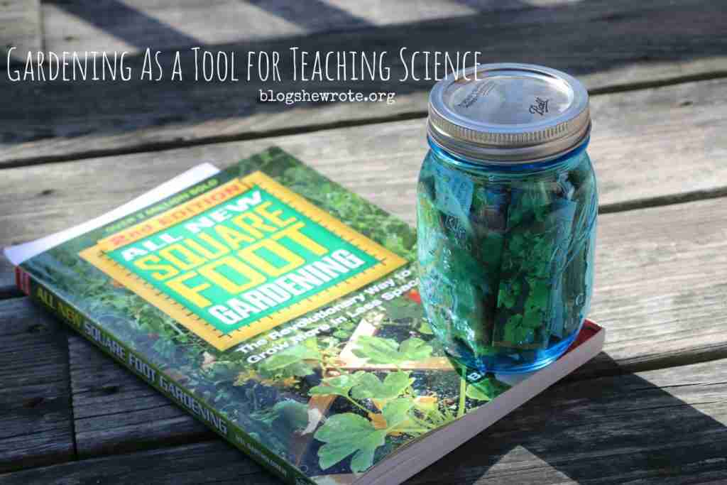 square foot gardening book on a wooden surface with a jar of seeds on top