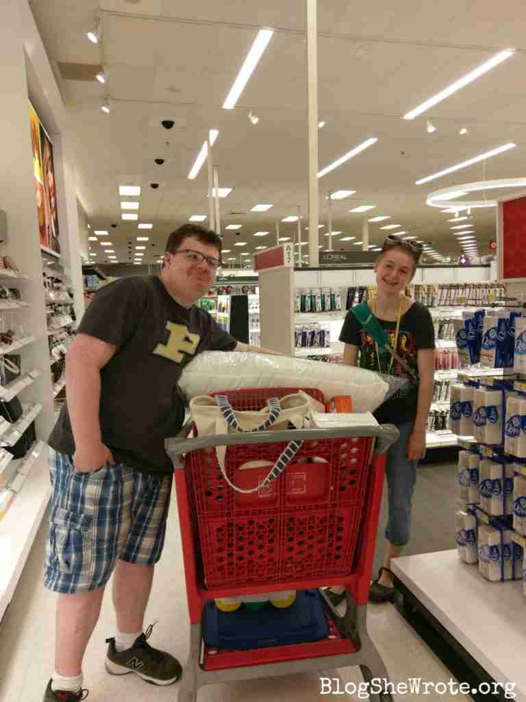 How to Thrive as Your Homeschool Shrinks- two high school graduates shopping in Target for dorm supplies and looking purposely haggard!