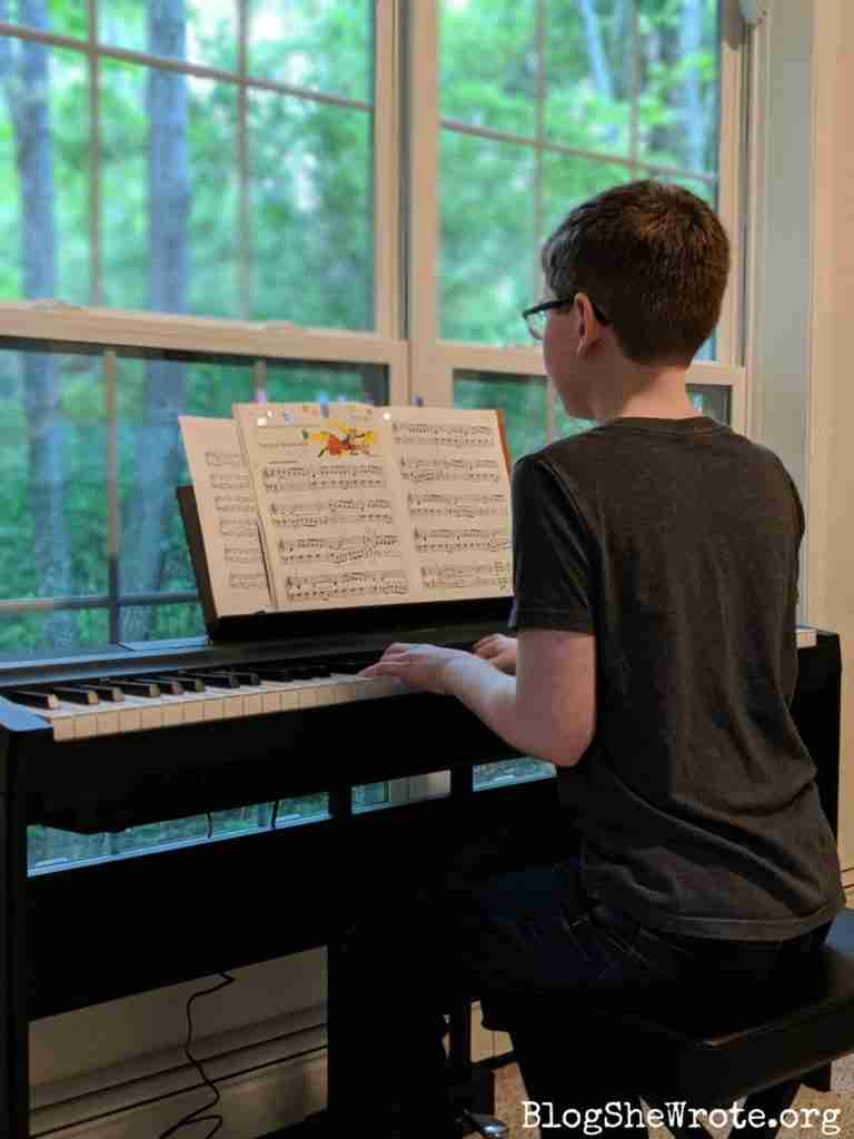 How to Thrive as Your Homeschool Shrinks- teen boy at a digital piano