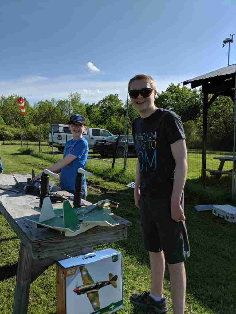 How to Thrive as your Homeschool Shrinks- two teen boys at a table with RC planes on a bright afternoon