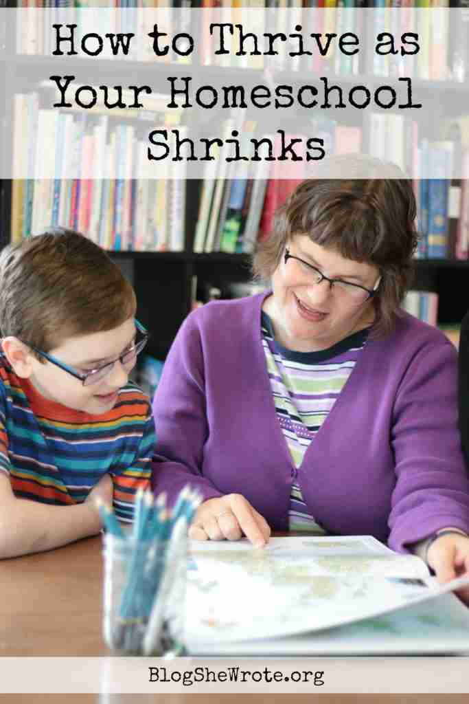 How to Thrive as Your Homeschool Shrinks- mom and a teen boy look over an atlas together at a table
