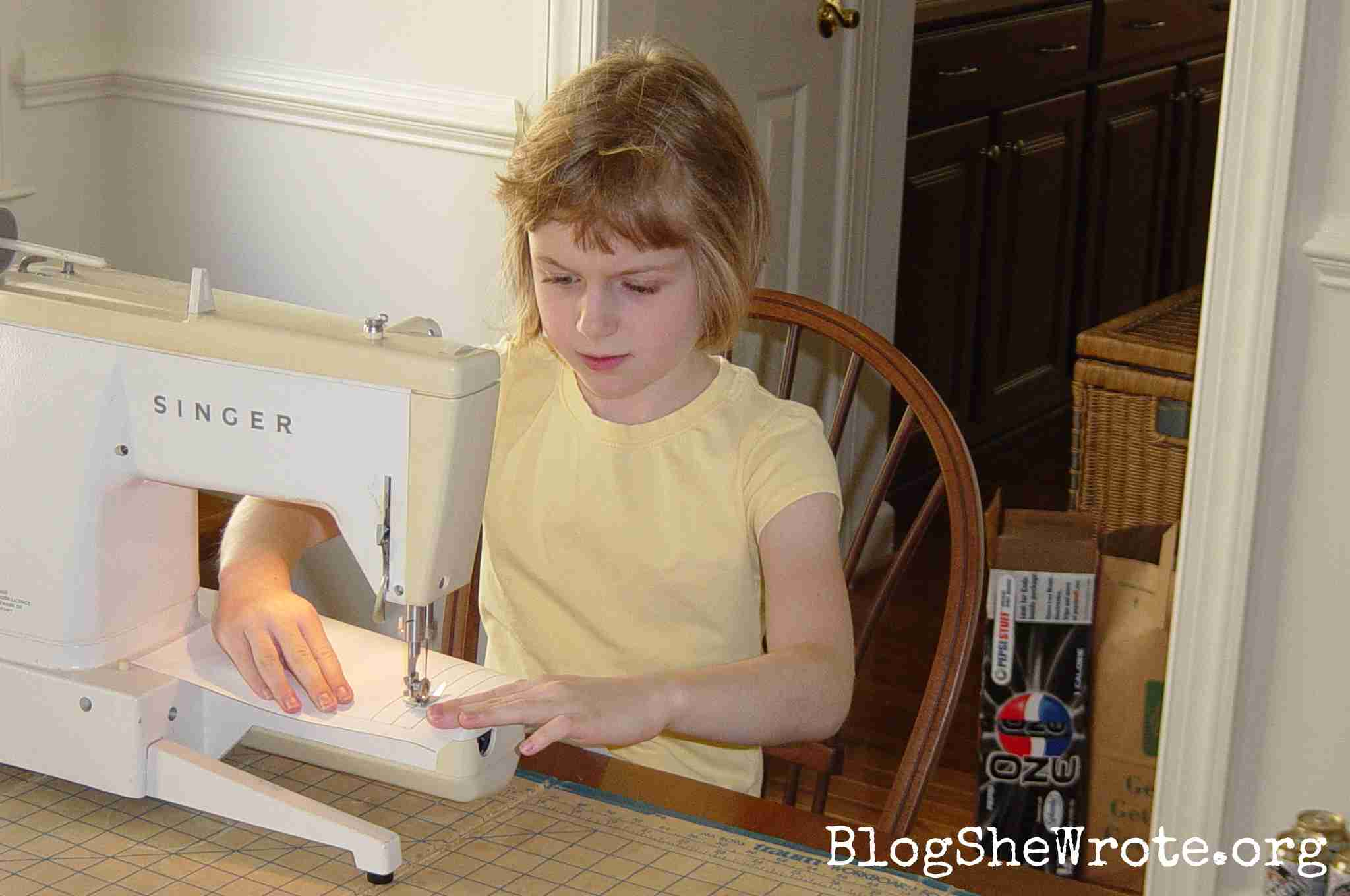 The Surprising Secret to Mentoring Out-of-the-Box Teens- Young girl at a sewing machine sewing lines on paper