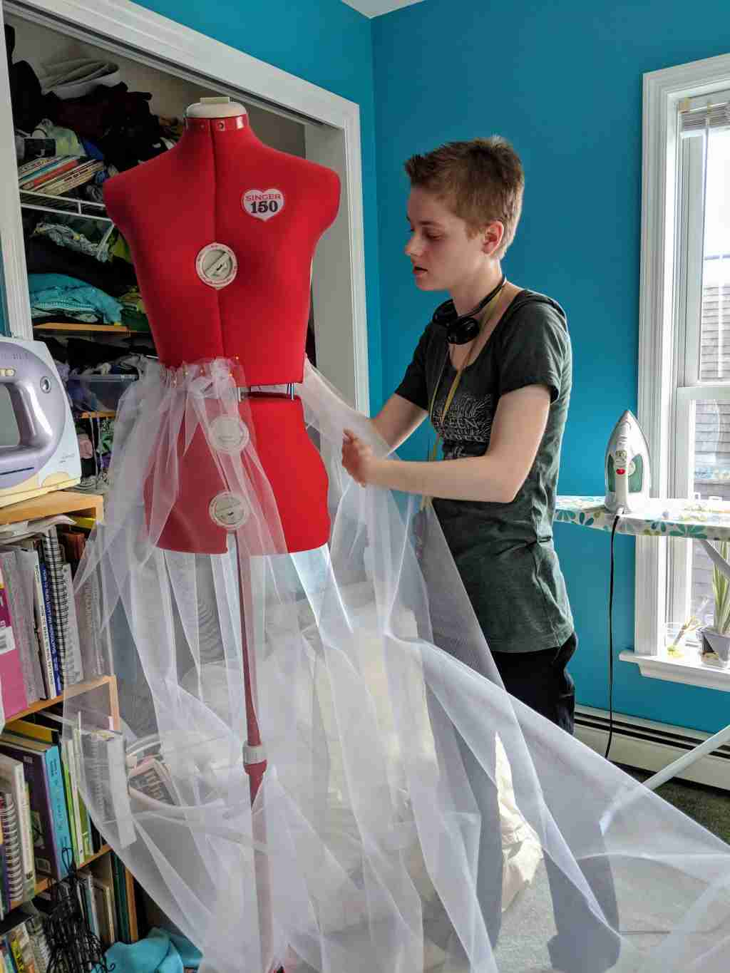 Homeschooling High School by Design- young woman at a dressform draping a skirt