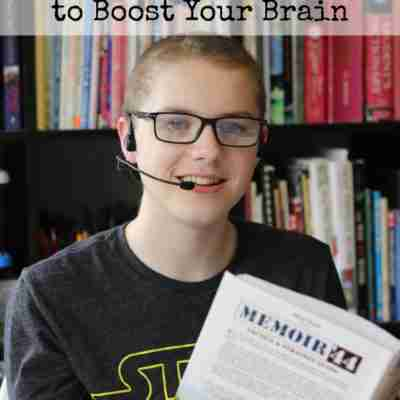 teen boy with a book and wearing a headset