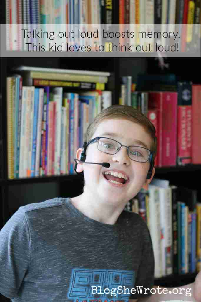 teen boy with a headset smiling big