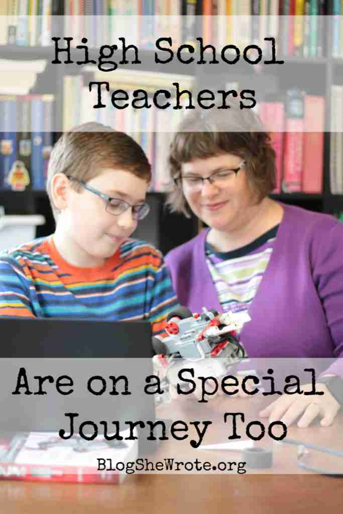 High School Teachers Are on a Special Journey Too- teen boy and me look at a mindstorm robot.