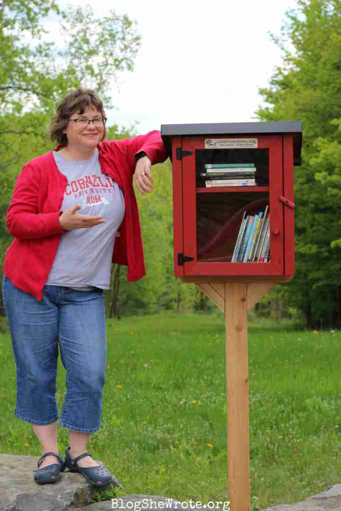 High School Teachers Are on a Journey Too- me standing next to my Little Free Library in 2019.