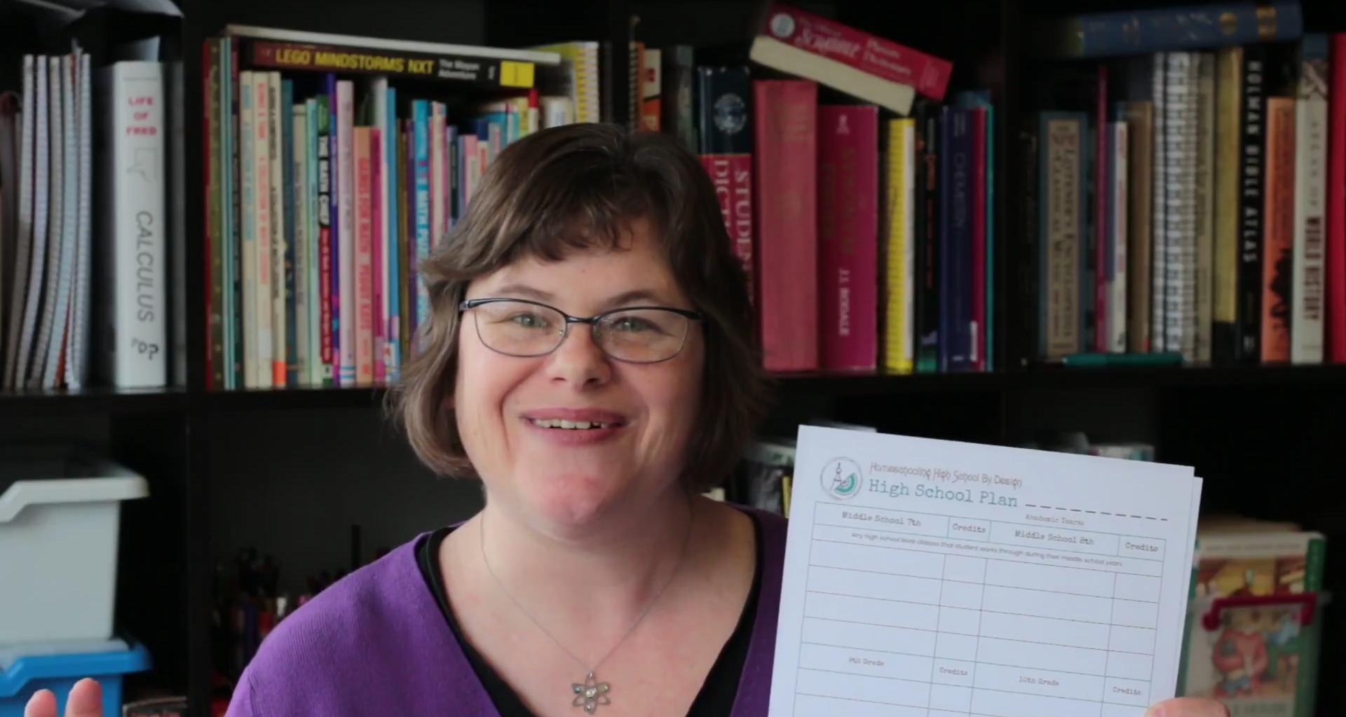 Homeschooling High School by Design- woman holding up a plan sheet