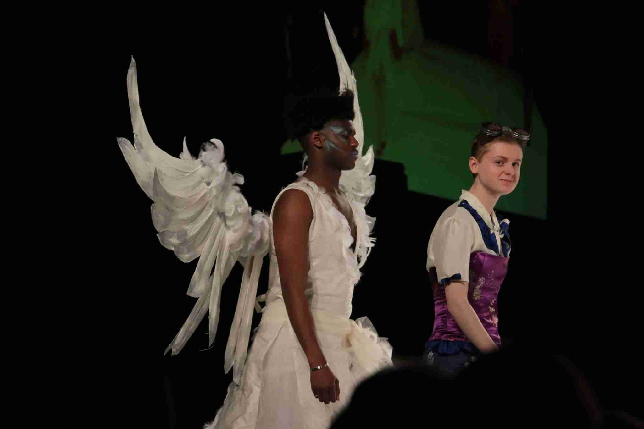 Homeschooling High School by Design- college fashion design student on the runway with her model and design