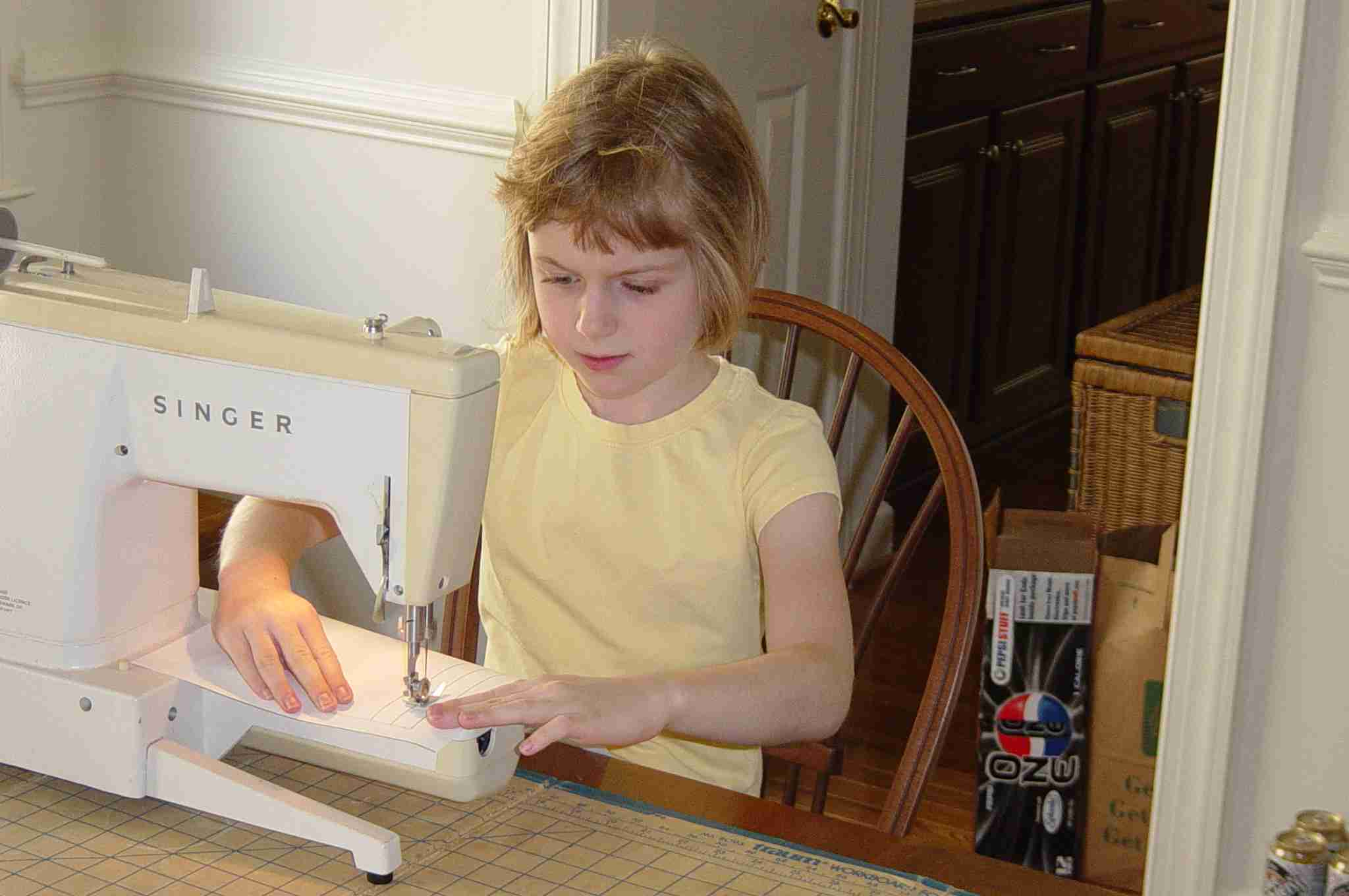 8yo girl at a sewing machine