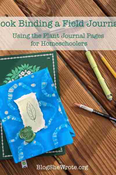 Book Binding the Plant Journal Pages for Homeschoolers- journal on a wood surface with drawing tools