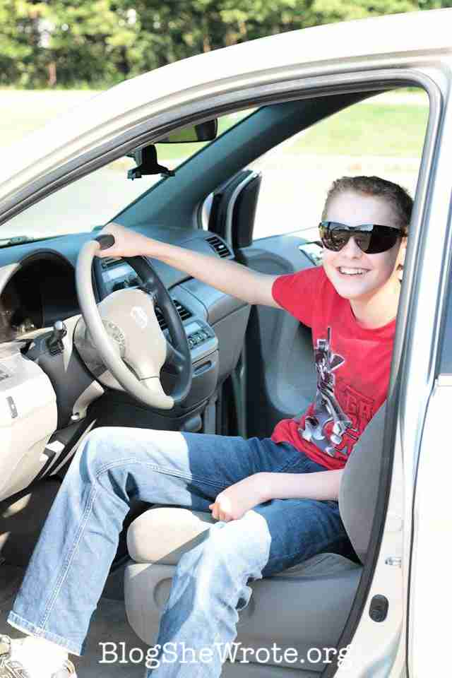 How to Avoid 7 Common Pitfalls of Homeschooling High School Planning- teen boy smiling from the driver's seat