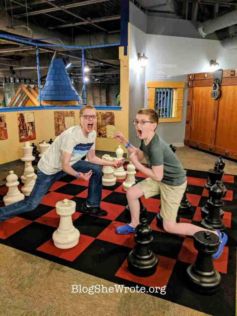 Why Little Women Isn't Just for Girls- two teen boys playing life size chess