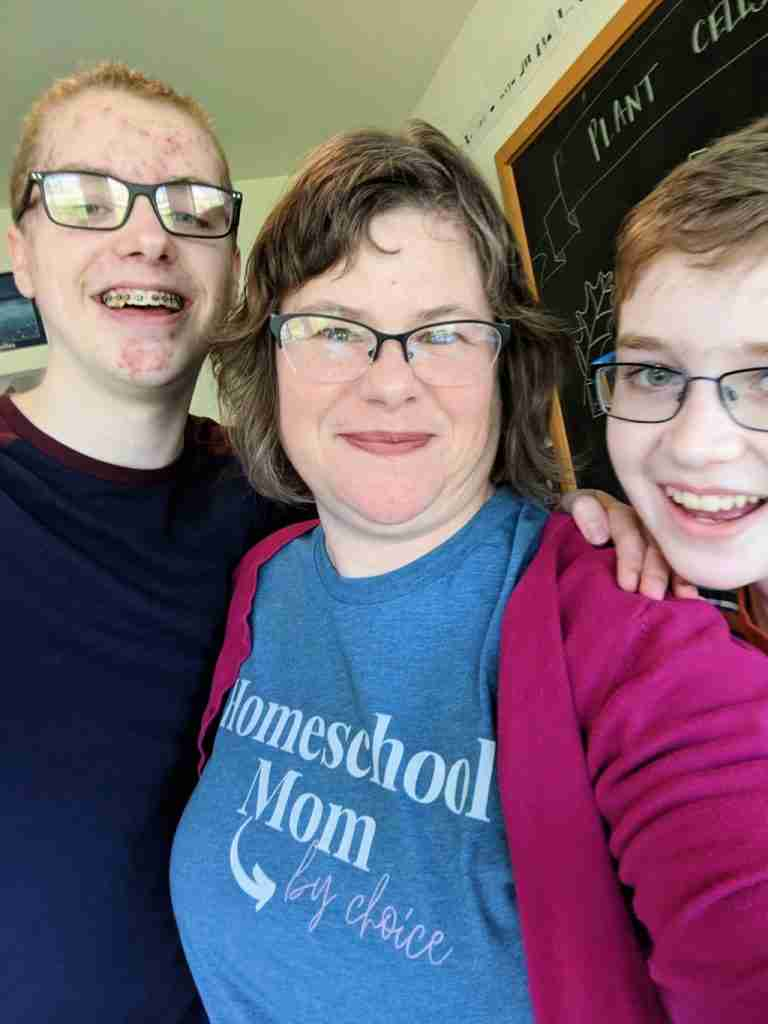 mom and two teen boys smiling