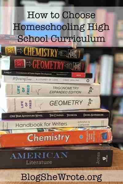 stack of books in front of a bookshelf